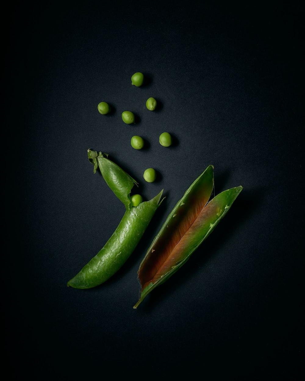 green chili pepper on black background