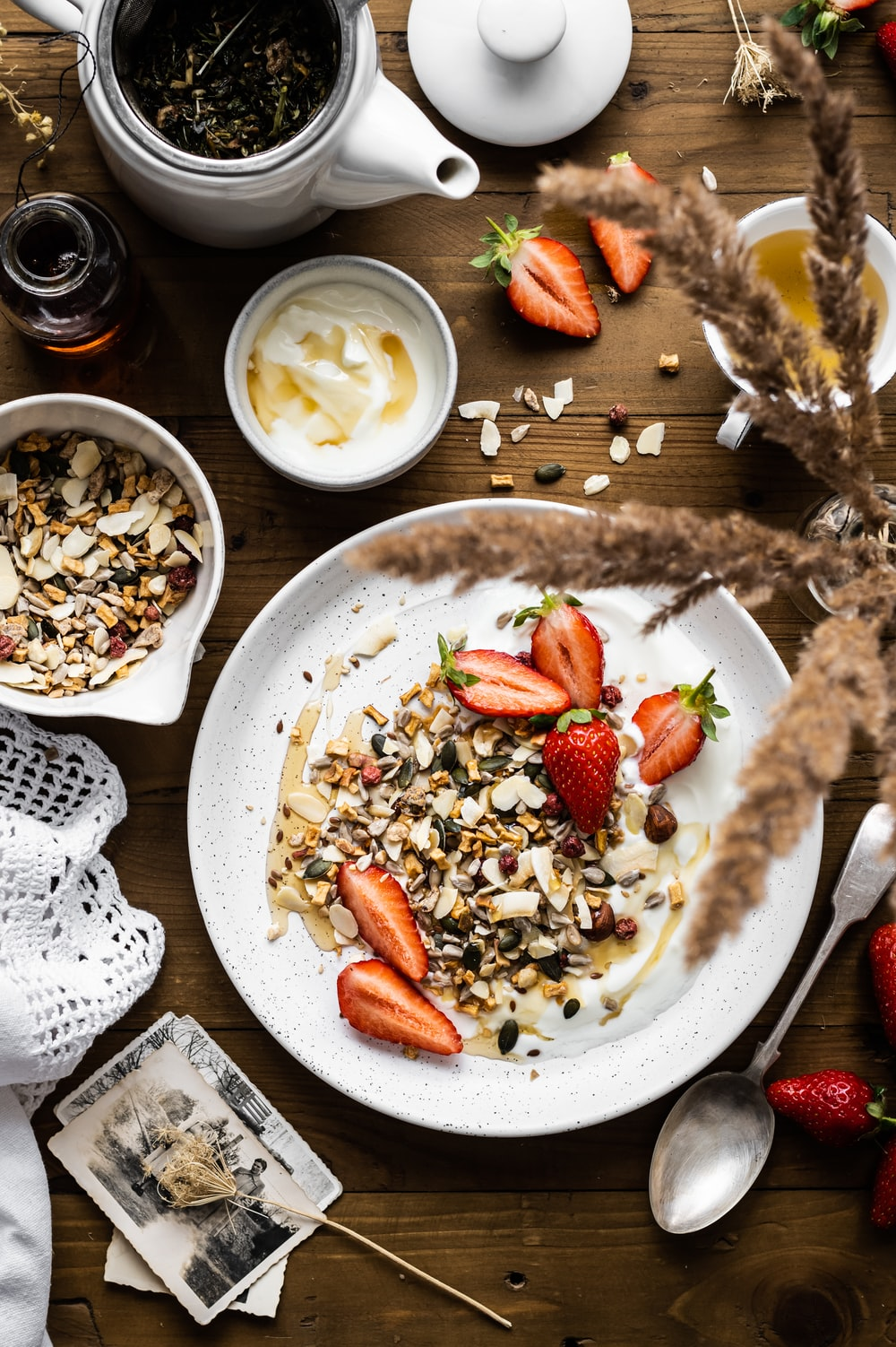 sliced strawberries and nuts on white ceramic plate