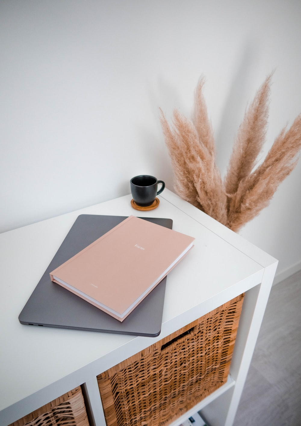 brown and black book on white table