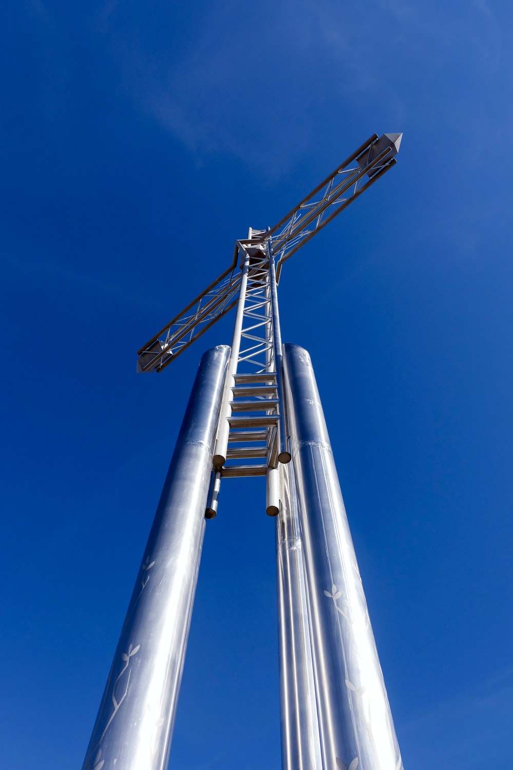 gray metal tower under blue sky during daytime