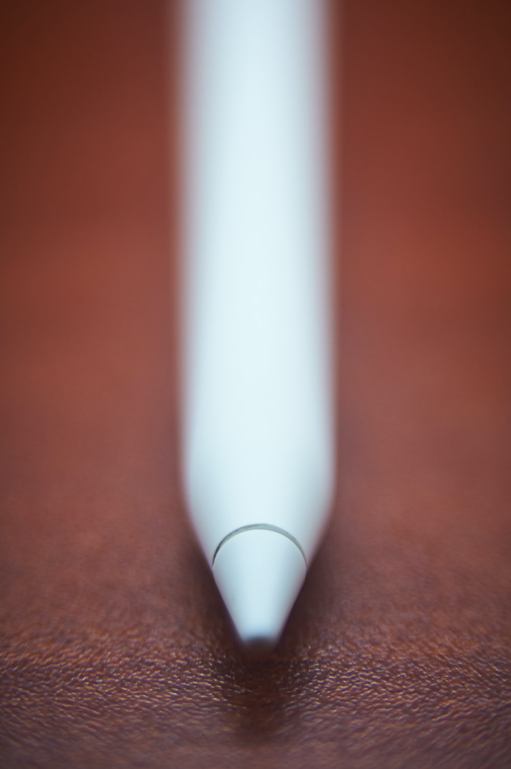 white pen on brown wooden table