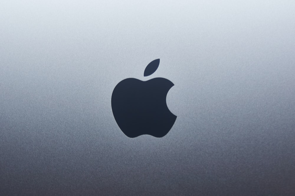 apple logo on blue surface