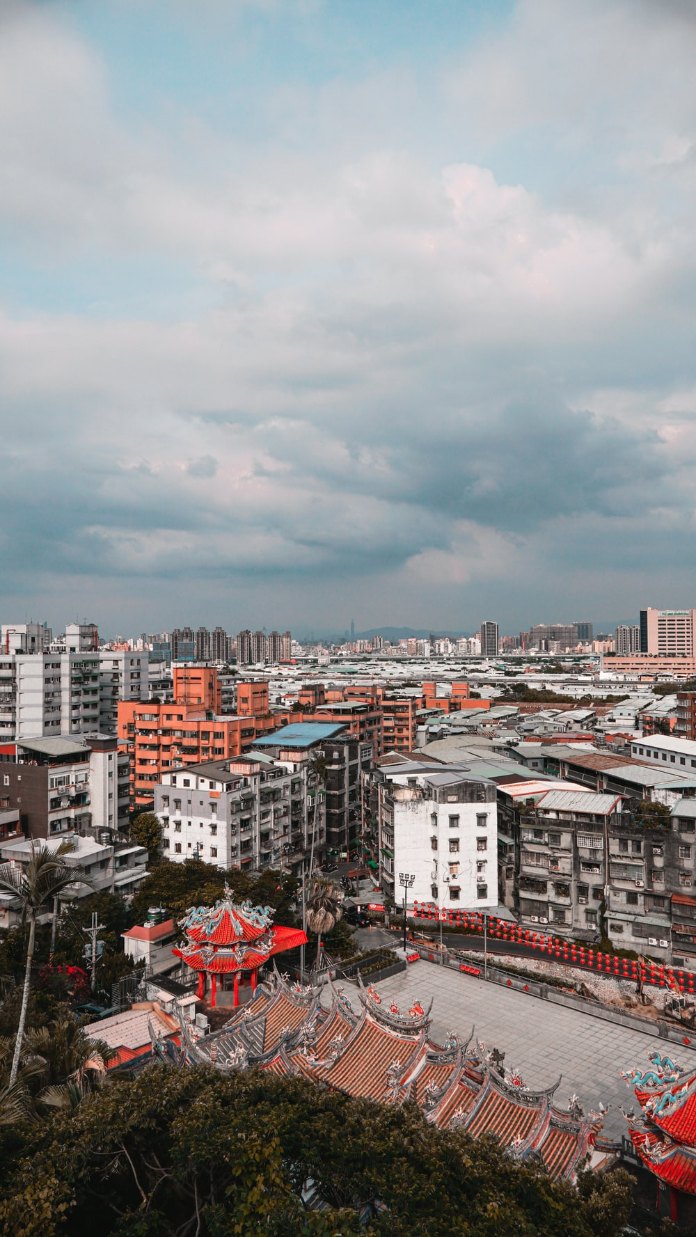 city buildings under cloudy sky during daytime