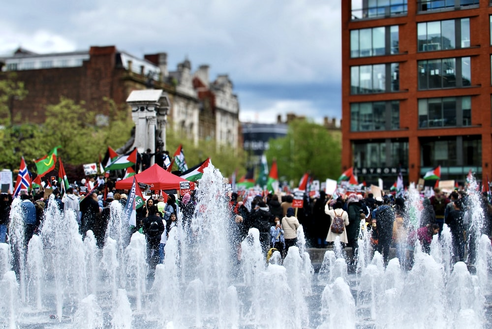 people in front of fountain during daytime