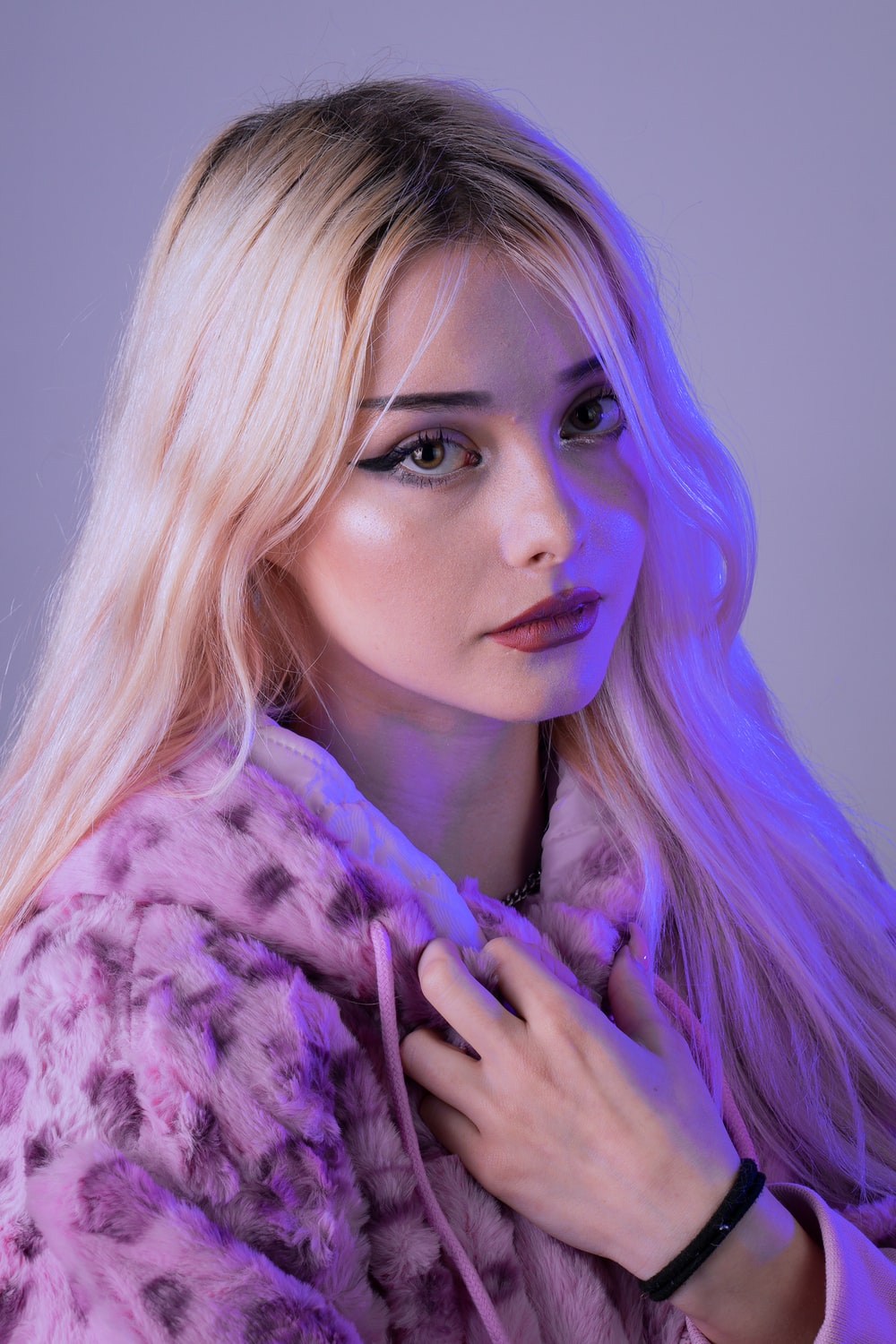 woman with purple hair wearing purple and white fur coat