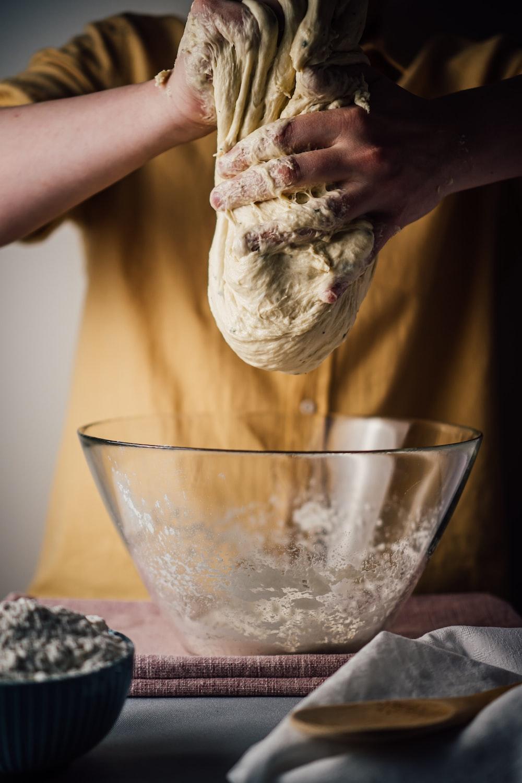 person holding white ice cream