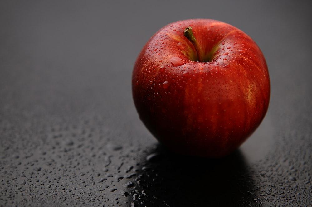 red apple fruit on black surface