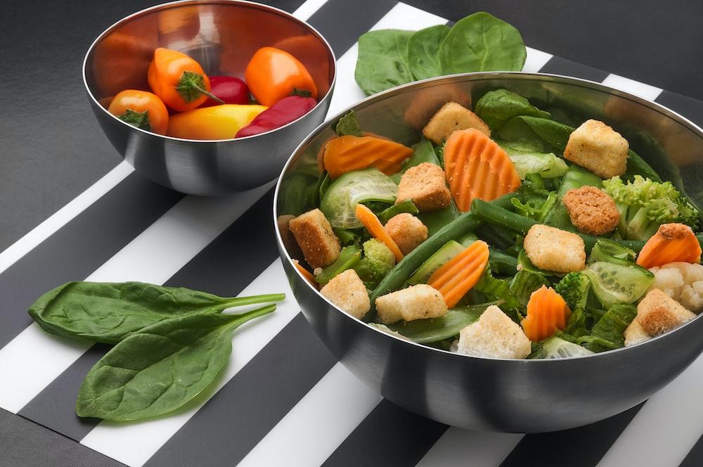 sliced vegetables on stainless steel bowl
