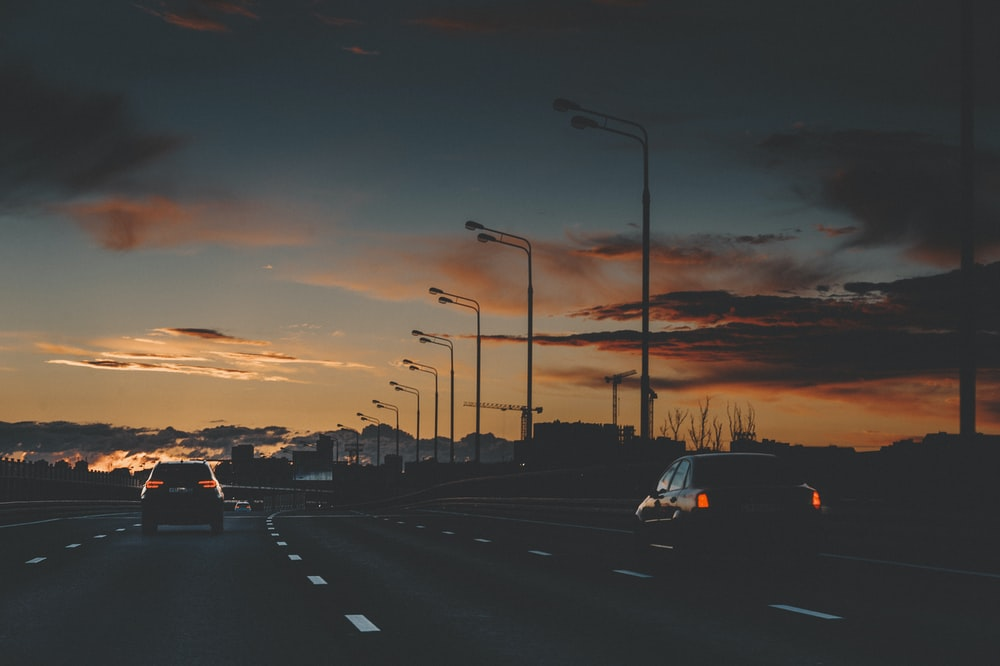cars on road during sunset