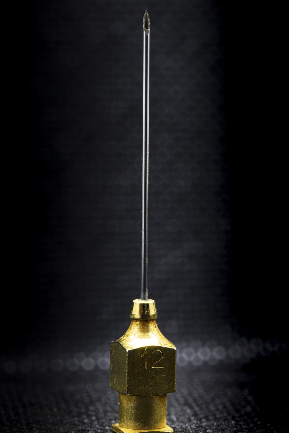 gold bell on black surface