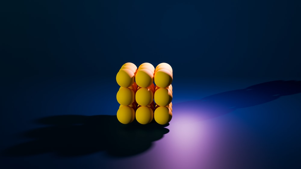 yellow round light on blue background