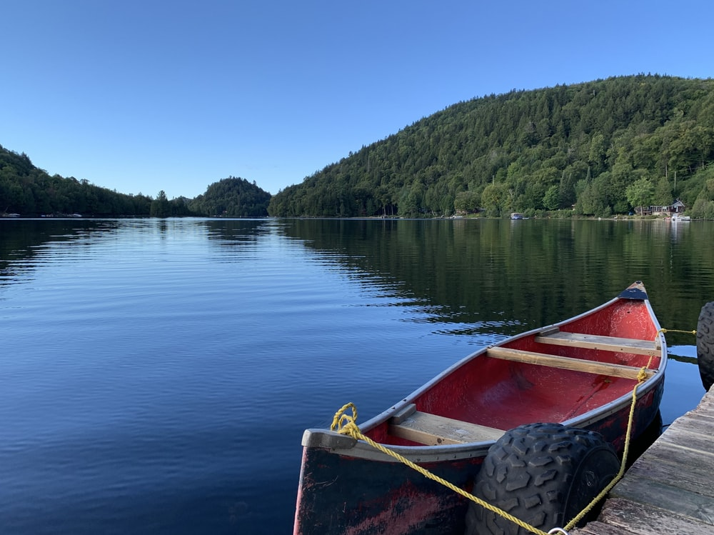 red boat on lake during daytime
