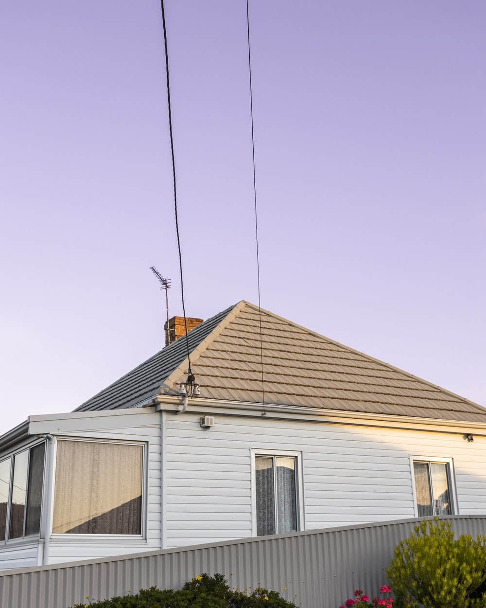 white and brown wooden house under blue sky during daytime