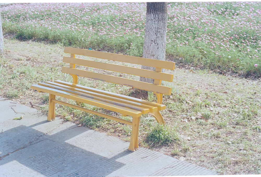 brown wooden bench on gray concrete floor