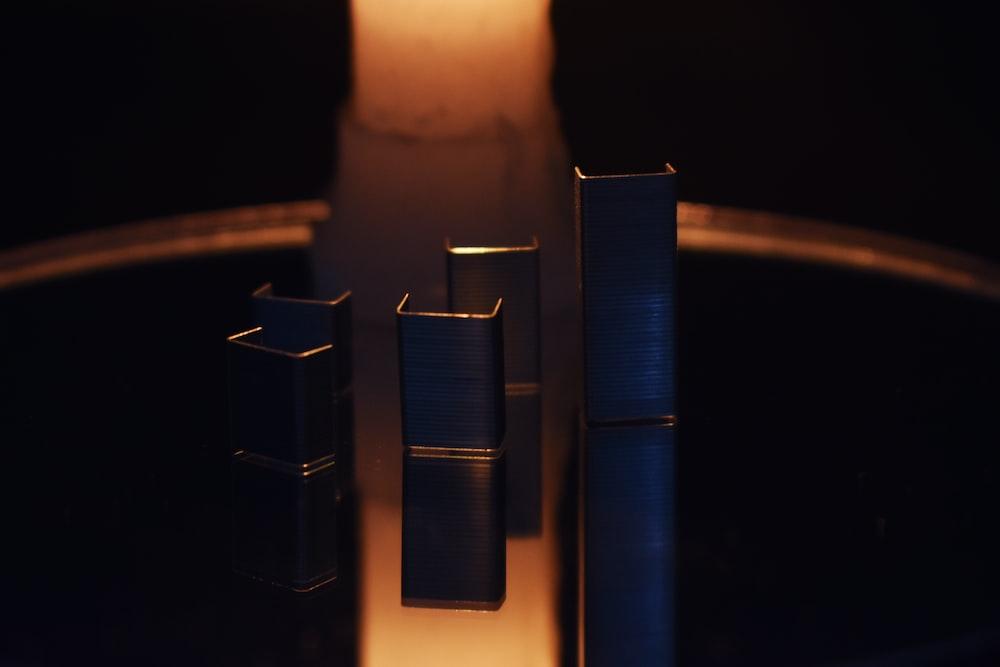 blue pillar candles on brown wooden holder