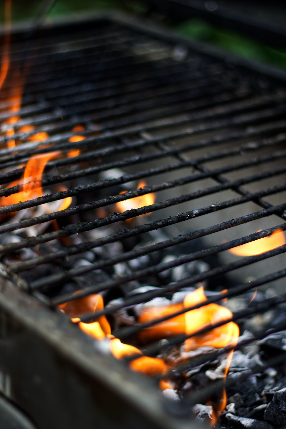 burning charcoal on charcoal grill
