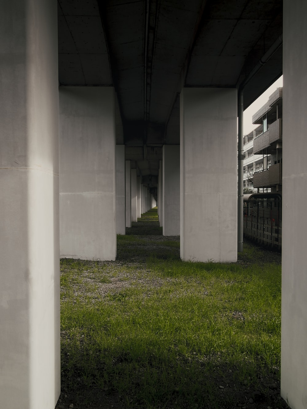 white concrete building with green grass field