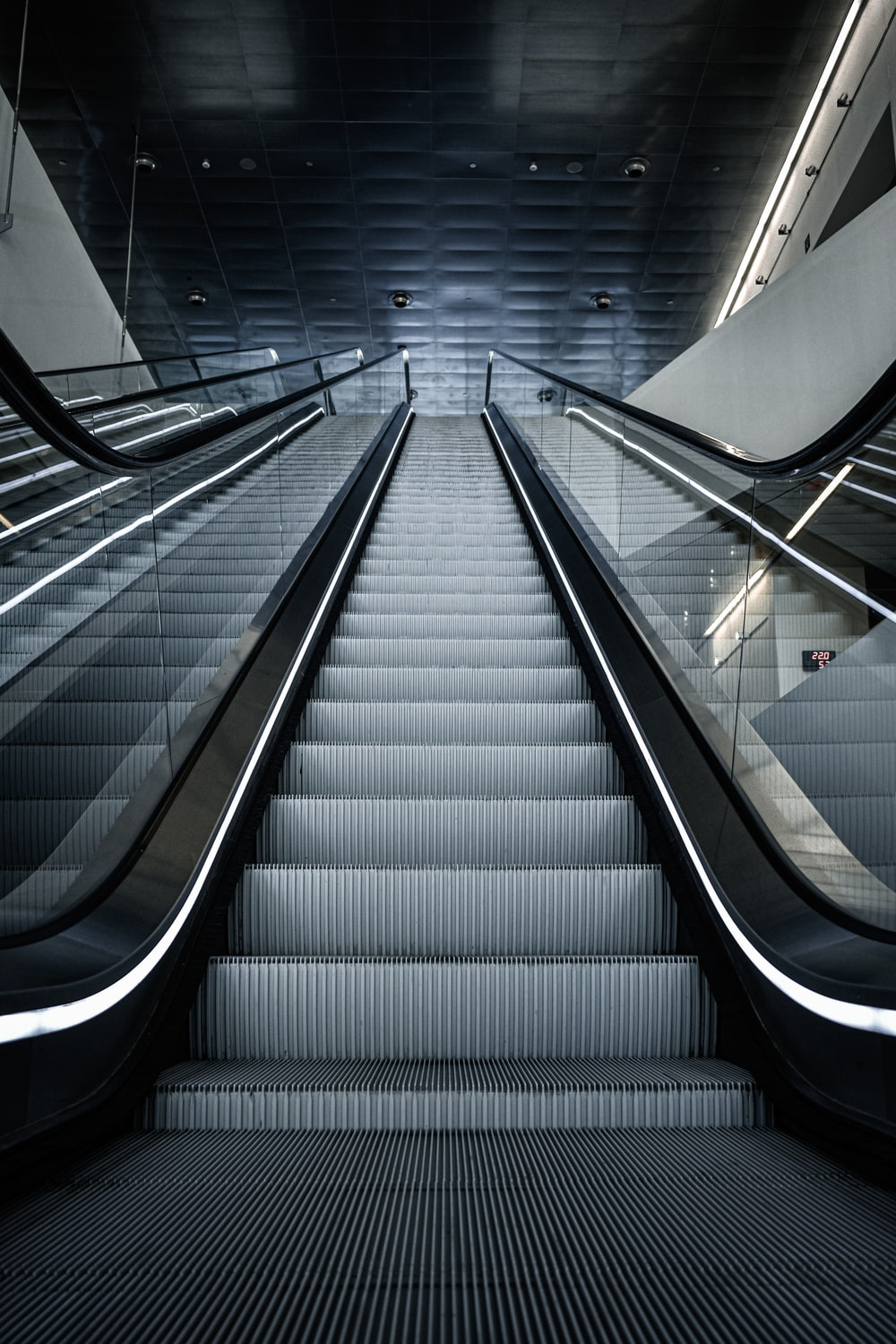 black and white escalator in a room