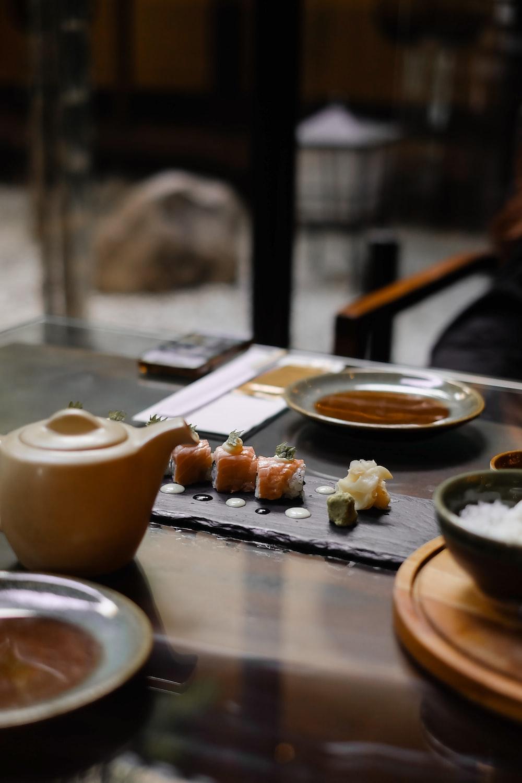 brown ceramic mug on brown wooden table
