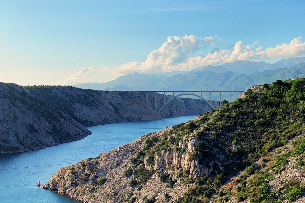 gray bridge over the river