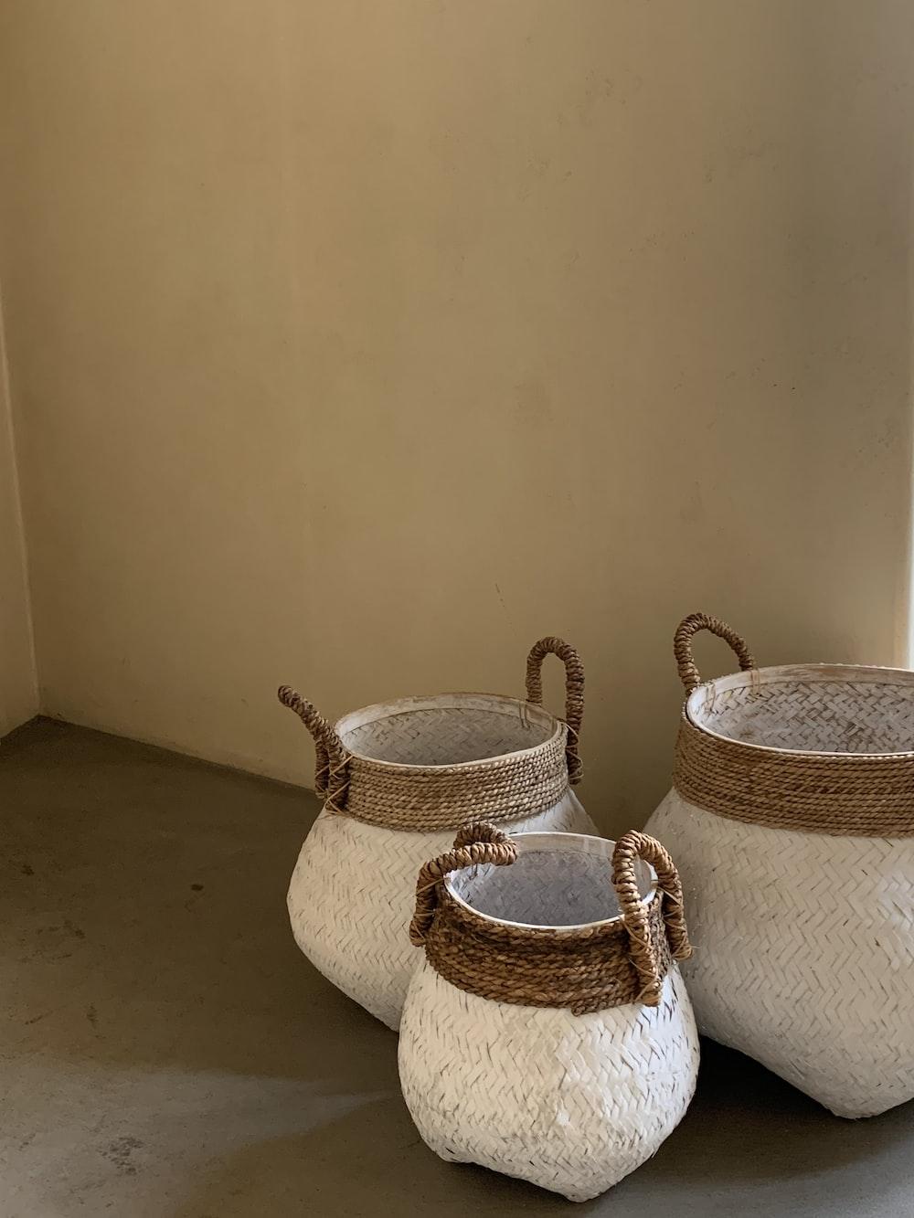 brown woven baskets on brown wooden floor