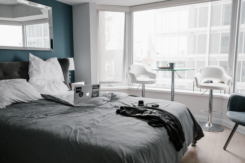 black bed linen near white table