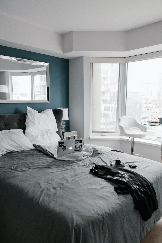 black bed linen on bed