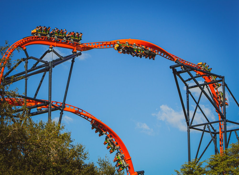 red and black roller coaster rail