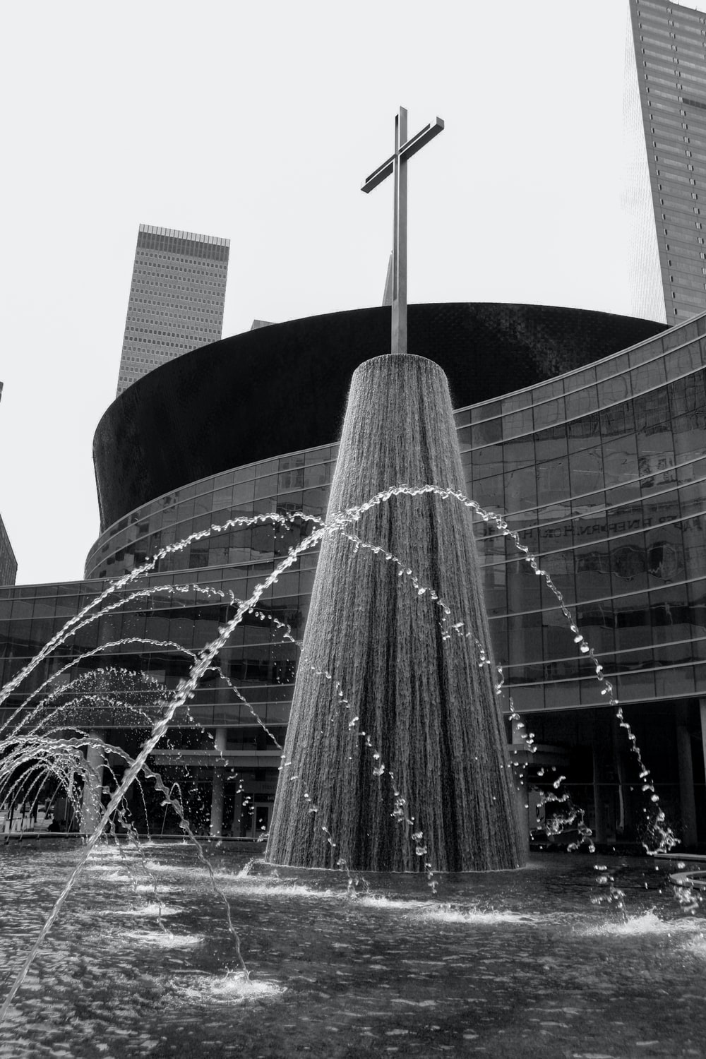 grayscale photo of water fountain