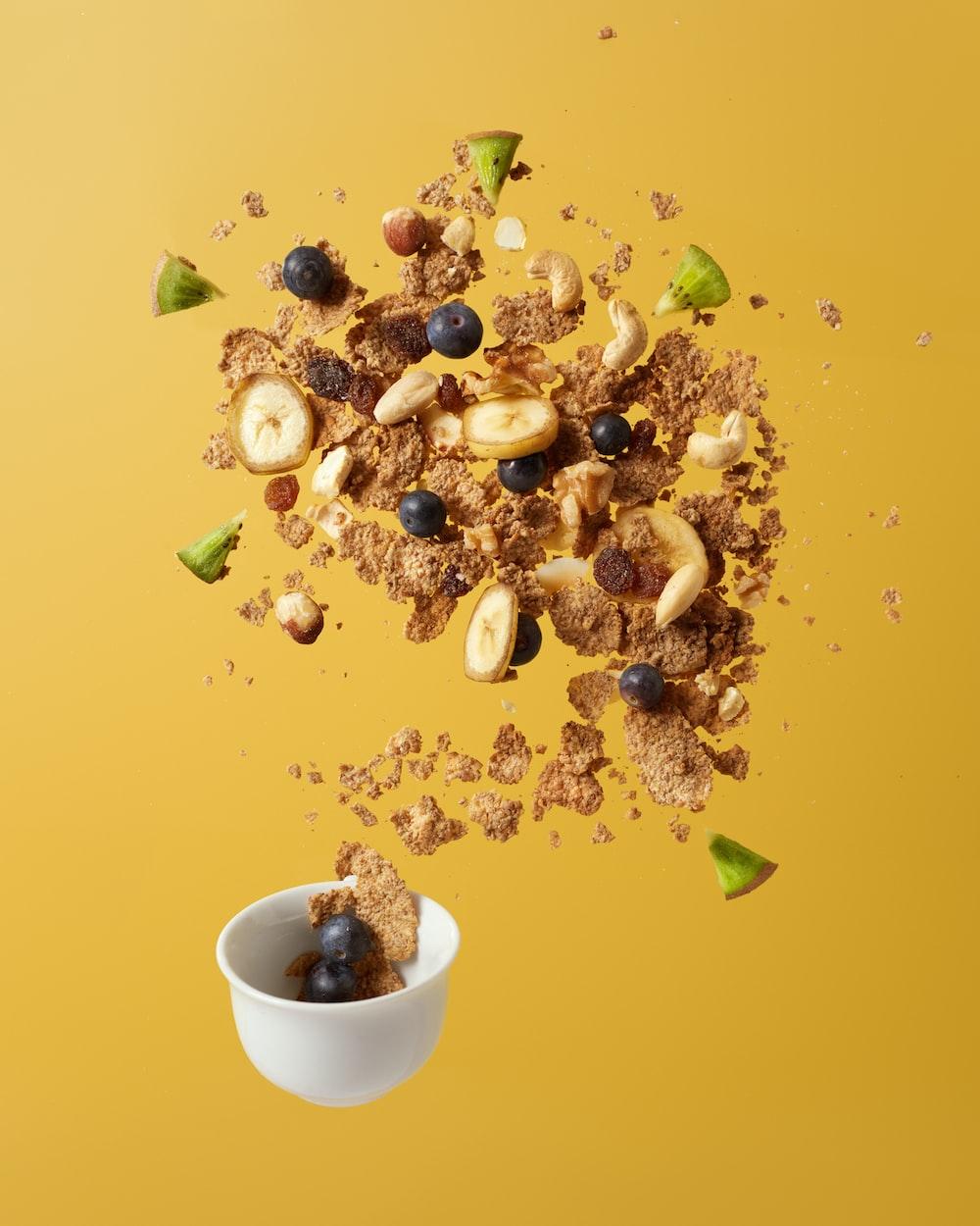 brown nuts on white ceramic bowl