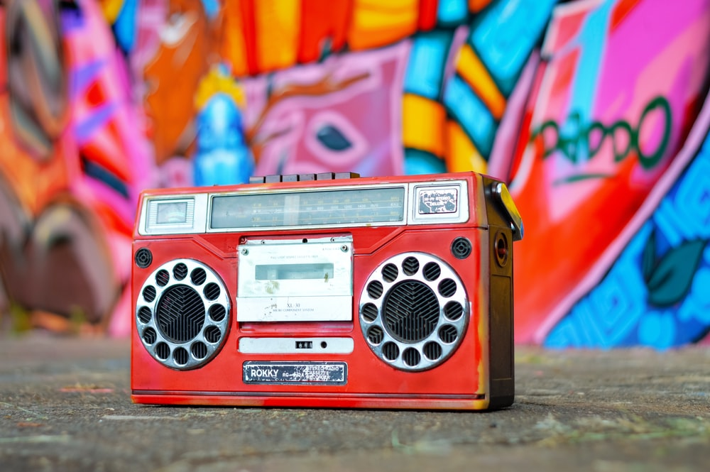 red and silver radio on pink and yellow textile