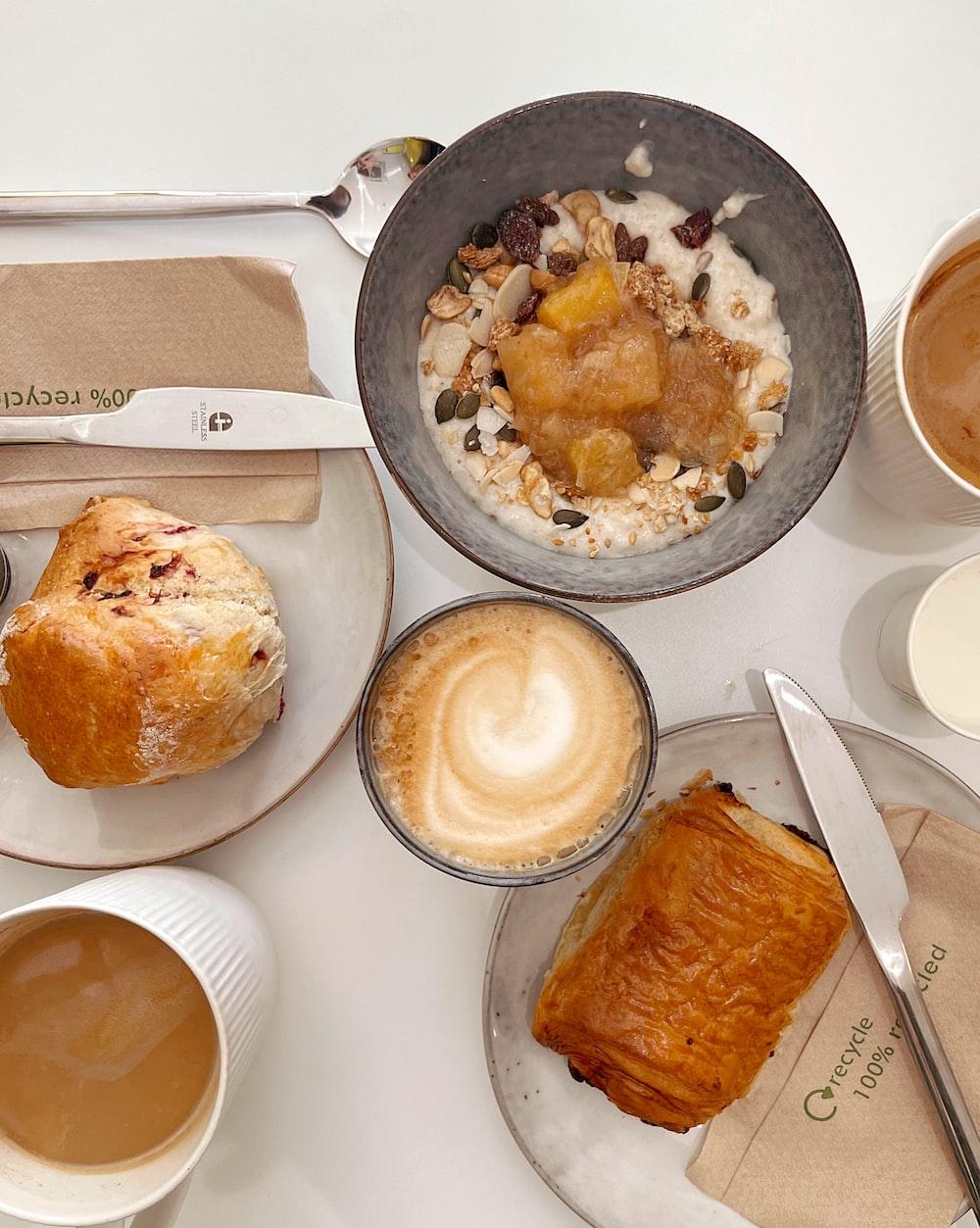 bread on white ceramic plate beside bread on white table