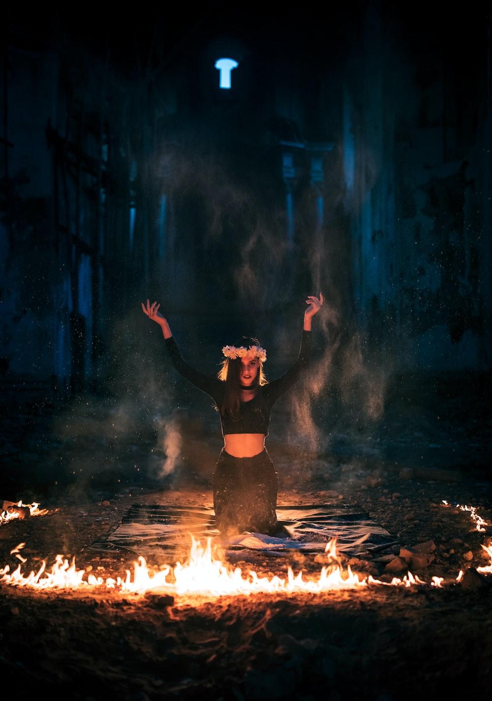woman in black dress standing on fire
