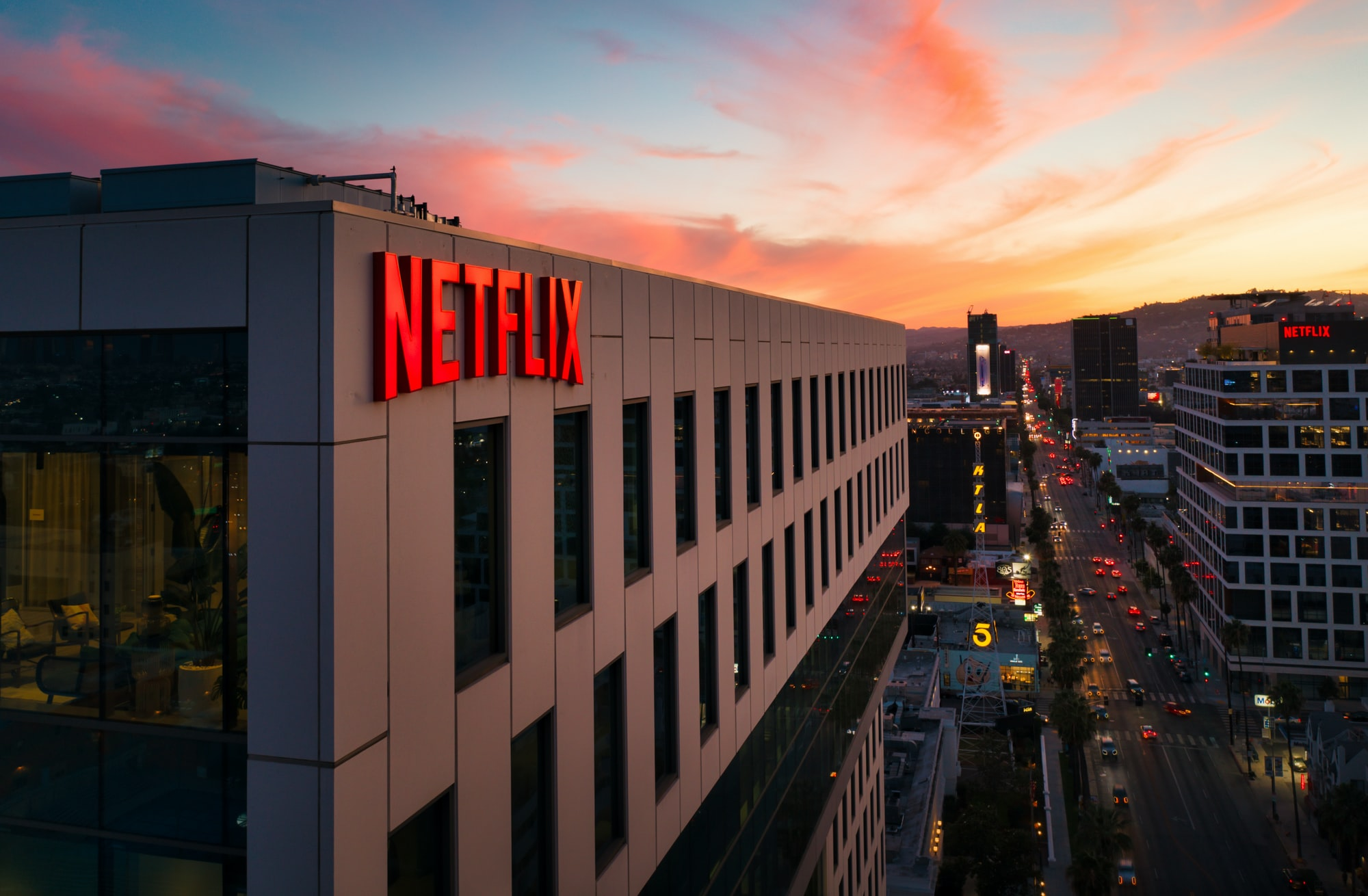 Netflix sign on a building at sunset.