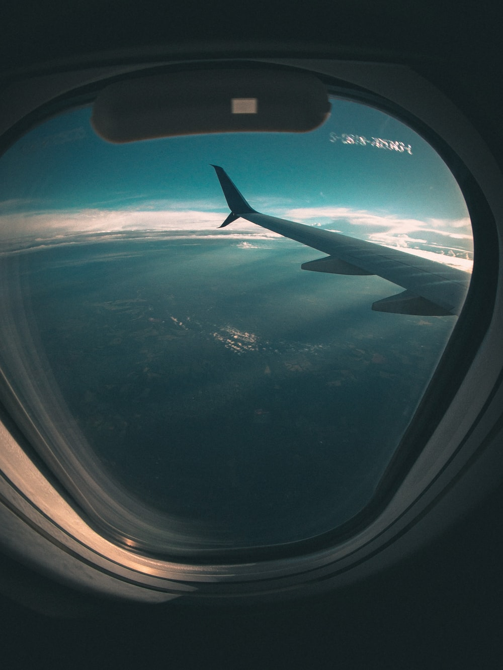 airplane window view of airplane wing