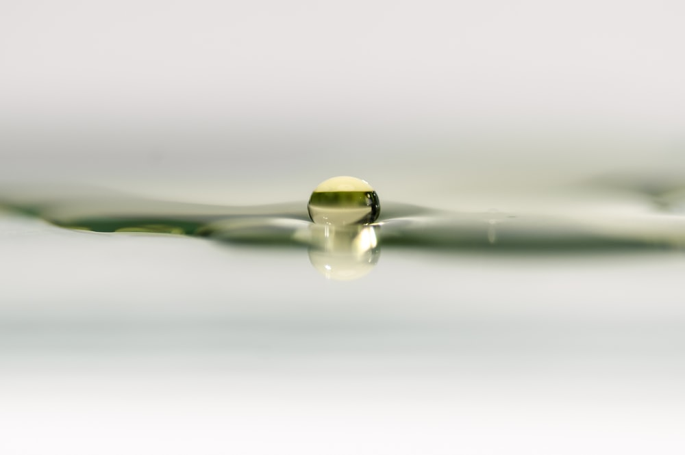 clear glass water drop in close up photography
