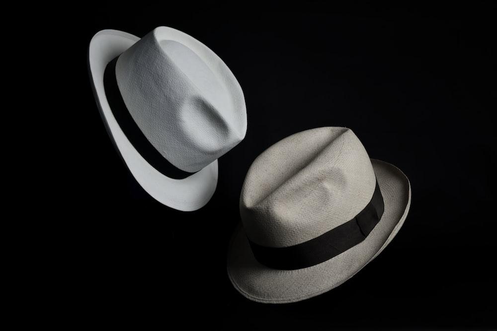 white cowboy hat on black background