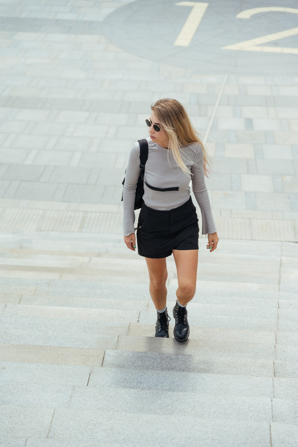 woman in black and white long sleeve shirt and black skirt