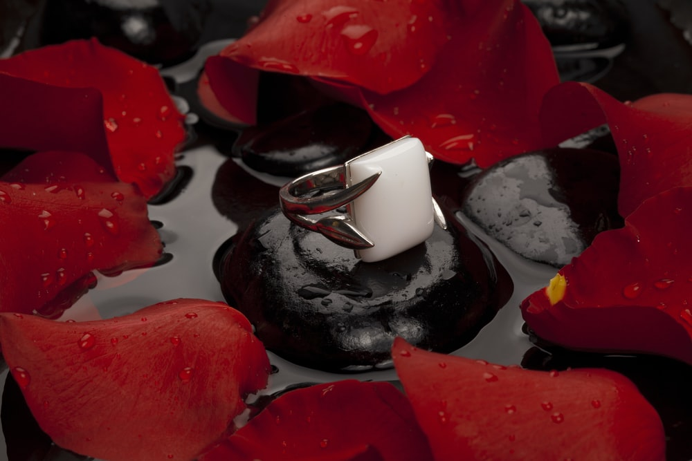 white ceramic teacup on black saucer