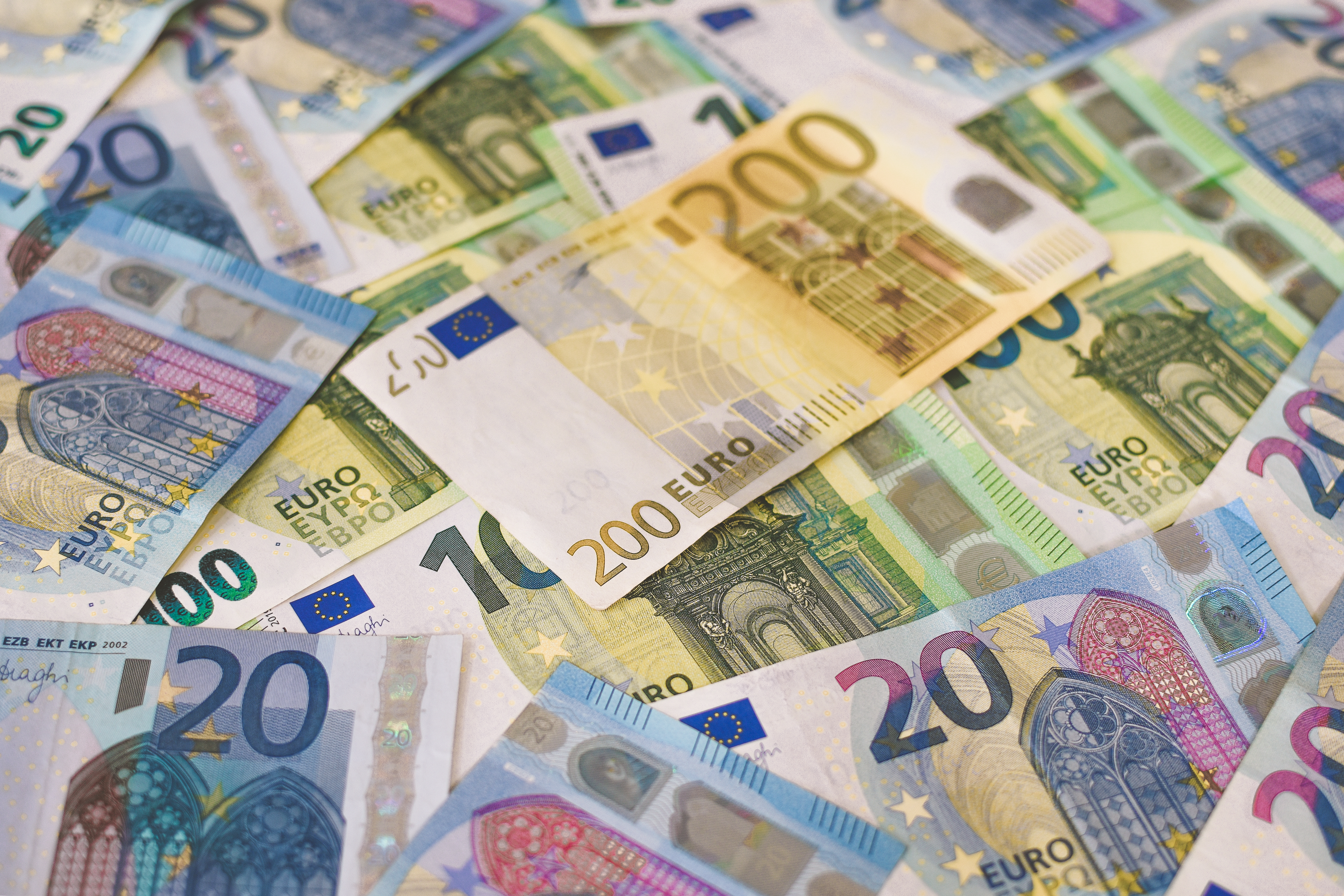 A pile of Euro (EUR) banknotes that include 20, 100, and 200 notes. (Part IV)