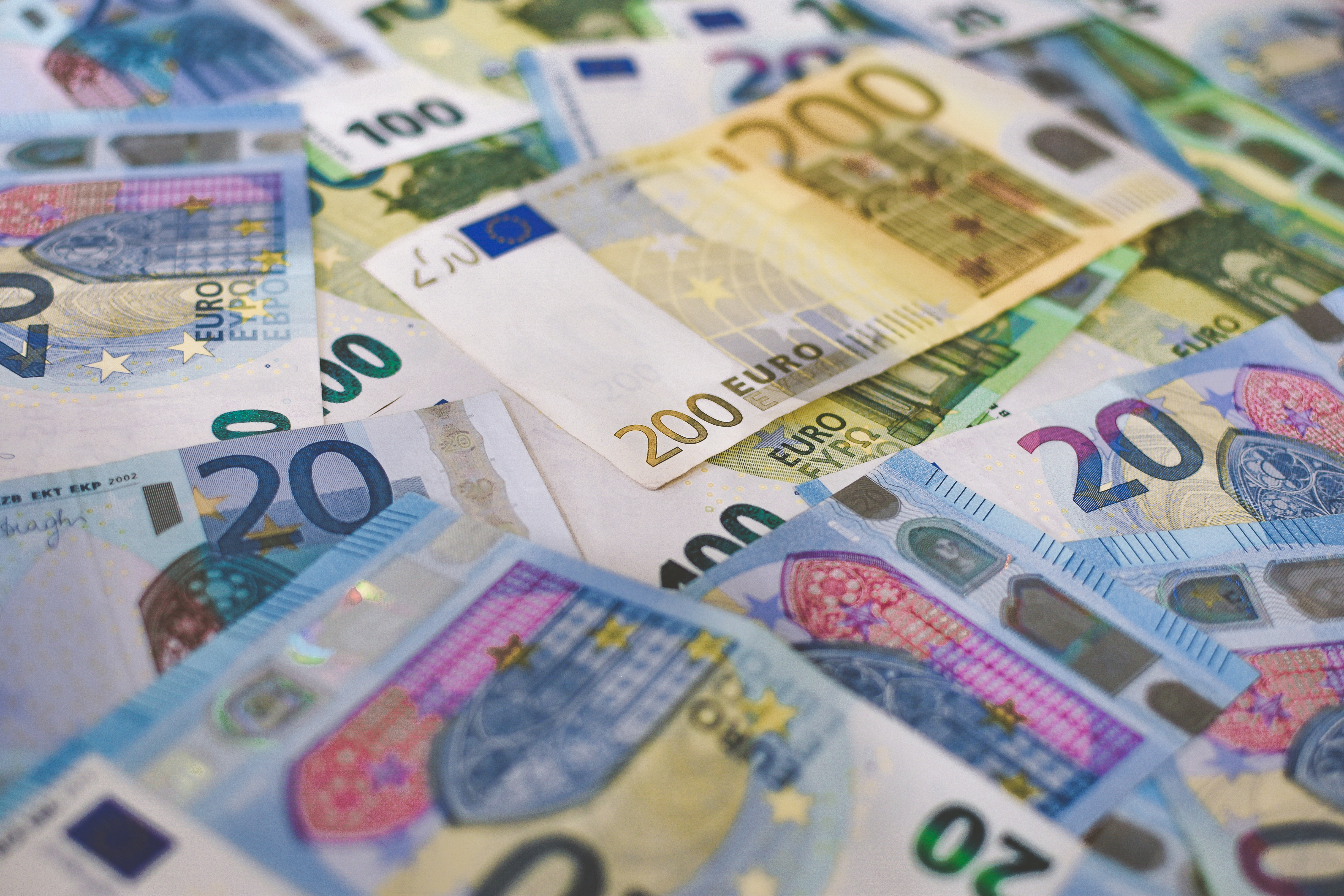 A pile of Euro (EUR) banknotes that include 20, 100, and 200 notes. (Part V)