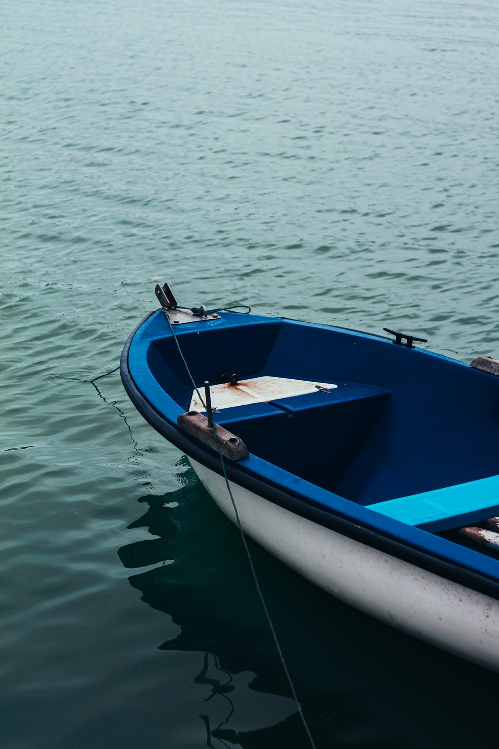 blue and white boat on water during daytime