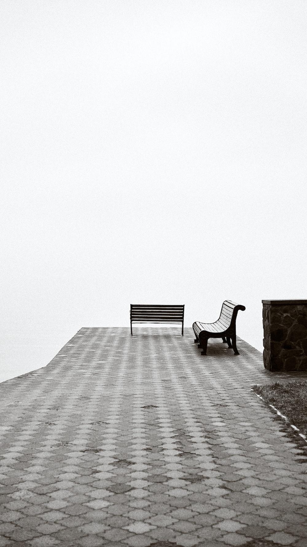 black metal bench on gray concrete floor