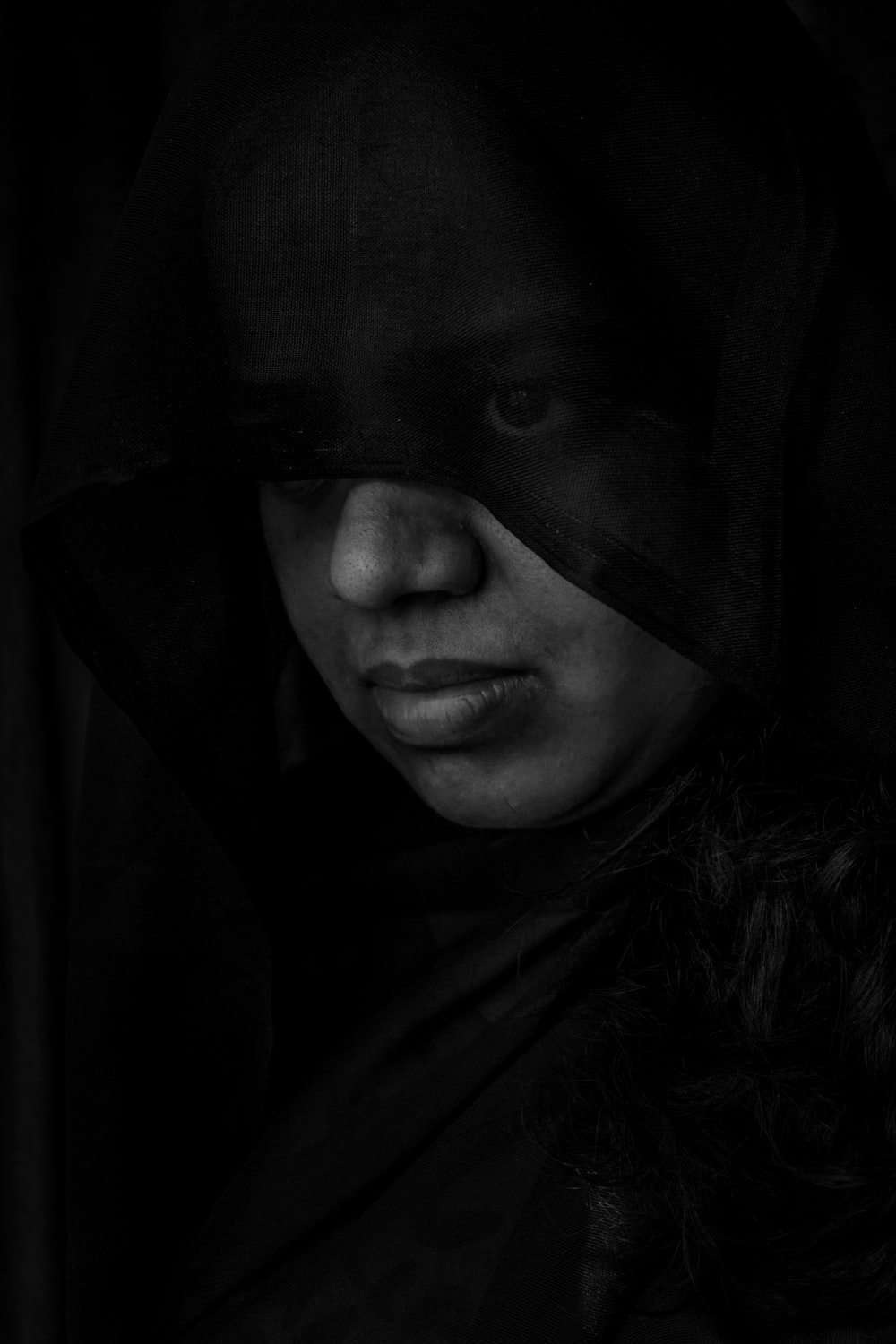 woman in black hijab in grayscale photography