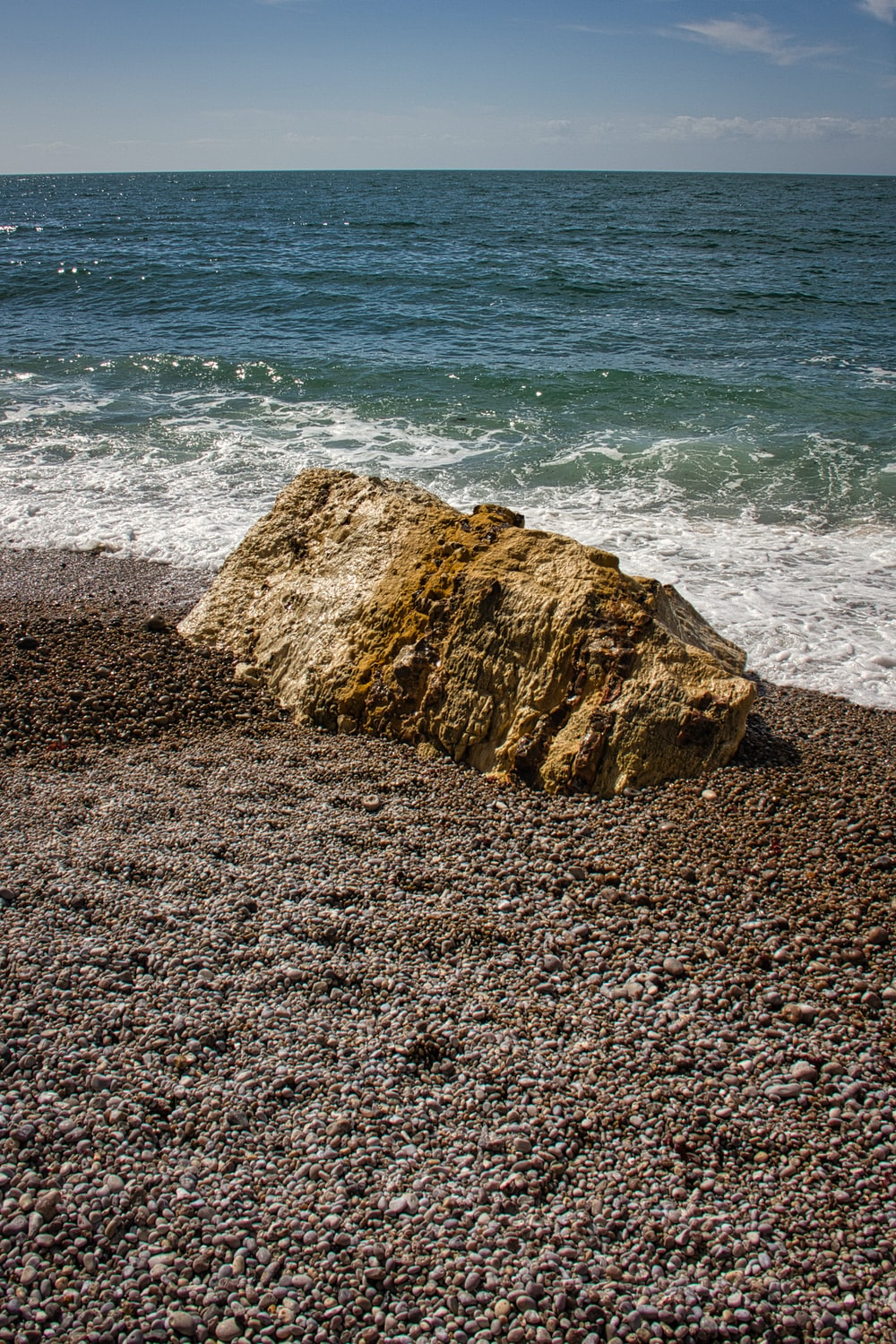 brown rock formation on seashore during daytime