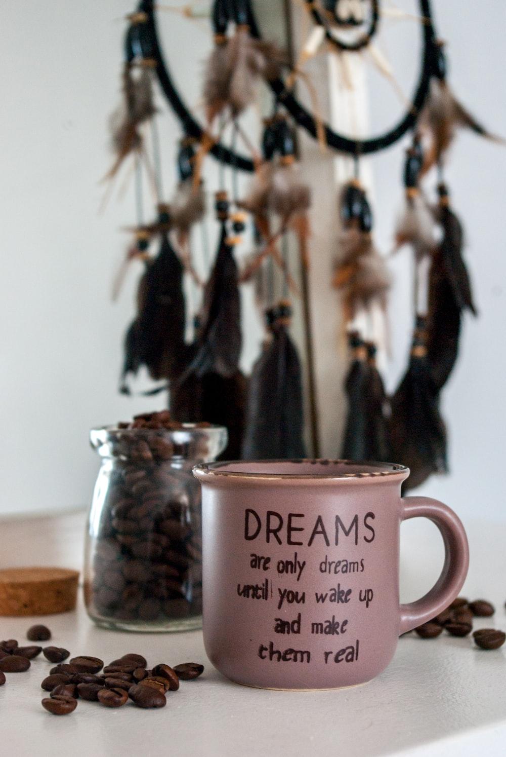 pink ceramic mug on brown wooden table