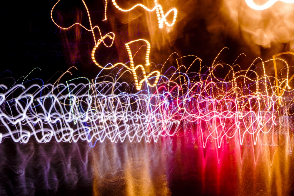 red and yellow lights on body of water