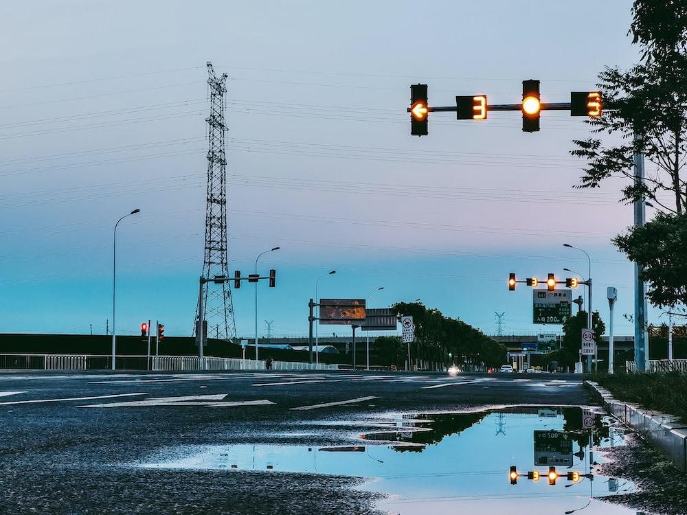 black street light near road during daytime
