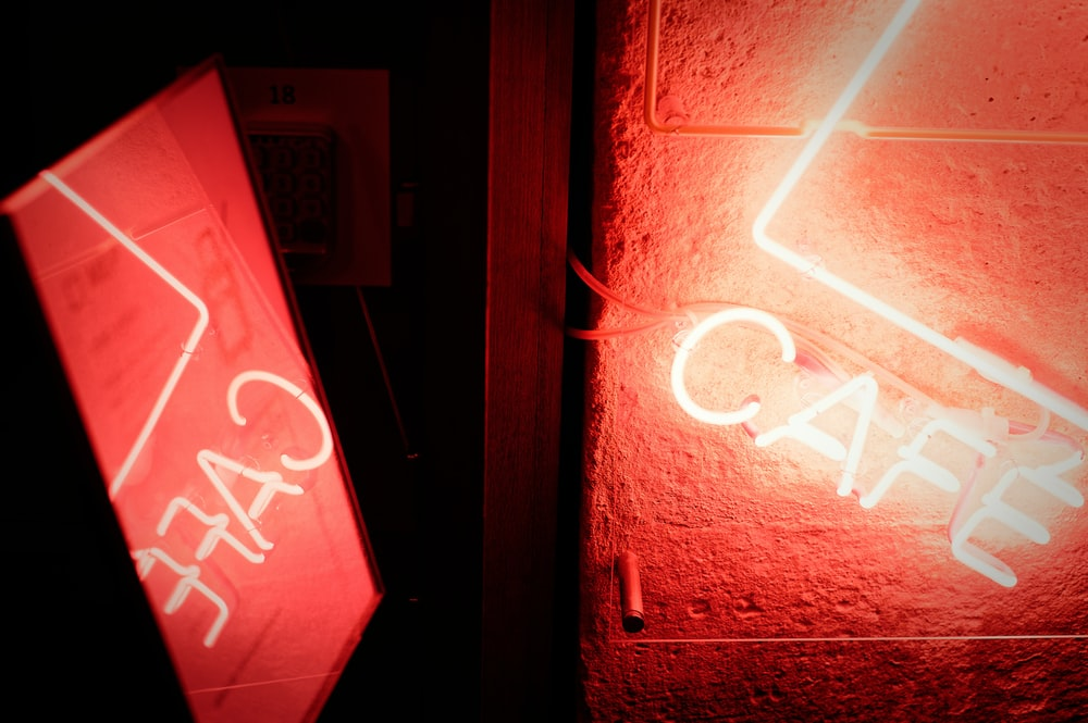red and white love neon light signage