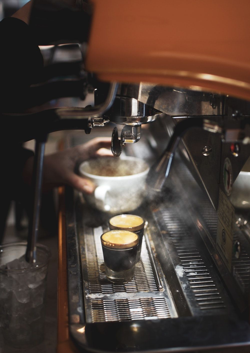 stainless steel cup on silver and brown espresso machine